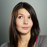 Attractive woman with a sceptical expression Stock Photos