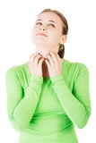 Attractive woman scratching her neck. Stock Photography