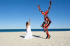 Attractive Woman and Sculpture at Beach Stock Photography