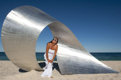 Attractive Woman and Sculpture at Beach Stock Photos