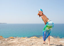 Attractive woman by the sea Stock Images