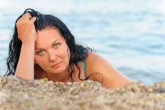 The attractive woman on seacoast Stock Image