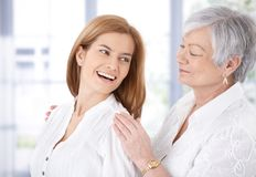 Attractive woman and senior mother laughing Royalty Free Stock Photography