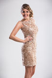 Attractive woman in sequin dress Stock Photos