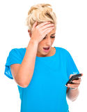 Attractive Woman Shocked by Cell Phone Message Royalty Free Stock Image