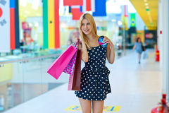 Attractive woman with shopping bags and credit cards Royalty Free Stock Photos