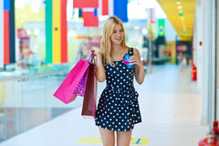 Attractive woman with shopping bags and credit cards Royalty Free Stock Images