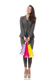 Attractive woman with shopping bags isolated on Royalty Free Stock Images