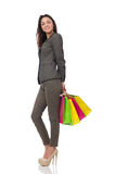 Attractive woman with shopping bags isolated on Stock Images