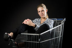 Attractive woman in shopping cart Royalty Free Stock Photos