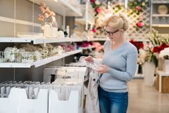 Attractive woman shopping at store. Let`s go shopping!. Attractive woman shopping at store. Let`s go shopping Royalty Free Stock Photos
