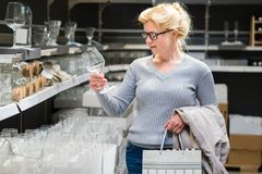 Attractive woman shopping at store. Let`s go shopping!. Attractive woman shopping at store. Let`s go shopping Stock Photo