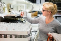 Attractive woman shopping at store. Let`s go shopping!. Attractive woman shopping at store. Let`s go shopping Stock Photos