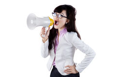Attractive woman shouting with megaphone. Picture of attractive woman shouting with megaphone in the studio Stock Photo