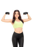 Attractive woman showing biceps Royalty Free Stock Image