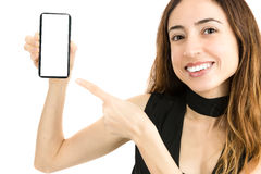 Attractive woman showing copy space on smart phone screen Stock Image