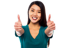 Attractive woman showing double thumbs up Stock Images