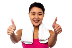 Attractive woman showing double thumbs up Stock Photos