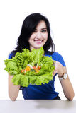 Attractive woman showing fresh salad Royalty Free Stock Images