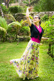 Peacock dance. One attractive woman was showing her peacock dance in garden Stock Images