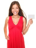 Attractive woman showing sign. Beautiful young smiling woman holding blank empty sign card or valentines day card with copyspace. American portrait of Asian Stock Images