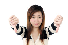 Attractive woman showing thumbs down sign Stock Photo