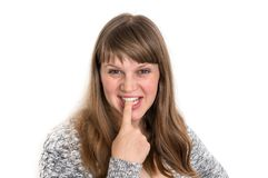 Woman showing tongue and is touching it with one finger stock image