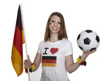 Attractive woman shows german flag and football Royalty Free Stock Image