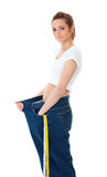 Attractive woman shows her old huge jeand, diet Stock Images