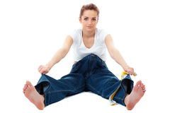 Attractive woman shows her old huge jeans, diet Royalty Free Stock Photo