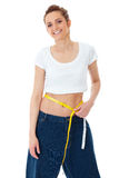 Attractive woman shows her old huge jeans, diet Royalty Free Stock Image