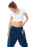 Attractive woman shows her old huge jeans, diet Stock Photos