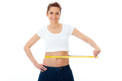 Attractive woman shows her old huge jeans, diet Stock Image