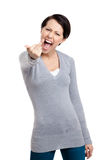 Attractive woman shows a vulgar finger sign Stock Photos