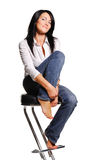 Attractive woman sits on bar chair. Isolated on white background Royalty Free Stock Image