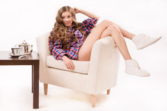 Attractive woman sitting on a armchair Stock Image