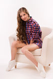 Attractive woman sitting on a armchair Royalty Free Stock Photography