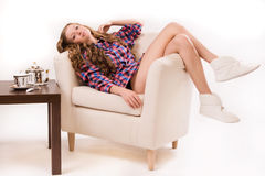 Attractive woman sitting on a armchair Stock Images