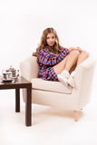 Attractive woman sitting on a armchair Royalty Free Stock Photos
