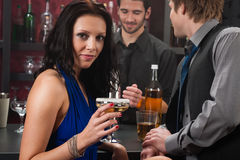 Attractive woman sitting at the bar drink Royalty Free Stock Photo