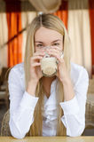 Attractive woman sitting in cafe Stock Images