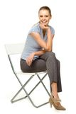 Attractive woman sitting on chair Royalty Free Stock Image