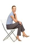 Attractive woman sitting on chair Royalty Free Stock Photos