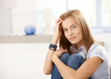 Attractive woman sitting on floor smiling Stock Photography
