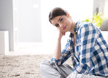 Attractive woman sitting on the floor Royalty Free Stock Images
