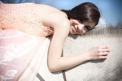 Attractive woman is sitting on the horse Stock Photography