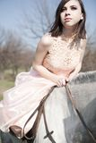 Attractive woman is sitting on the horse Stock Image