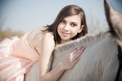 Attractive woman is sitting on the horse Royalty Free Stock Photography