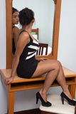 Attractive woman. Woman sitting near a mirror Stock Photos