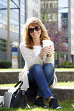 Attractive woman sitting outdoor Royalty Free Stock Photo